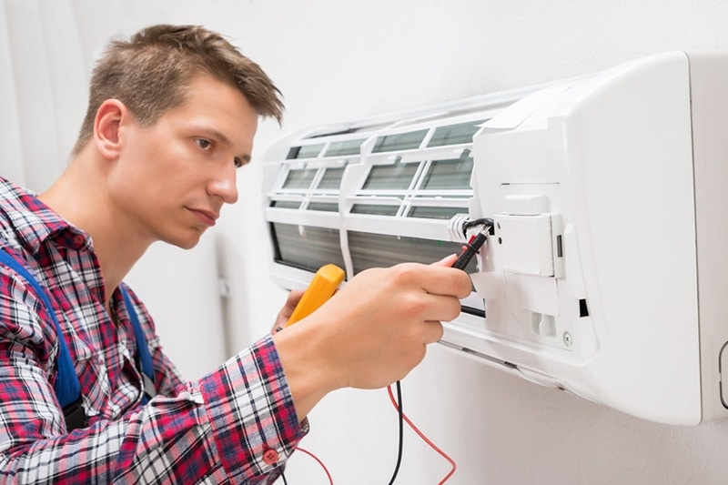 man fixing HVAC unit